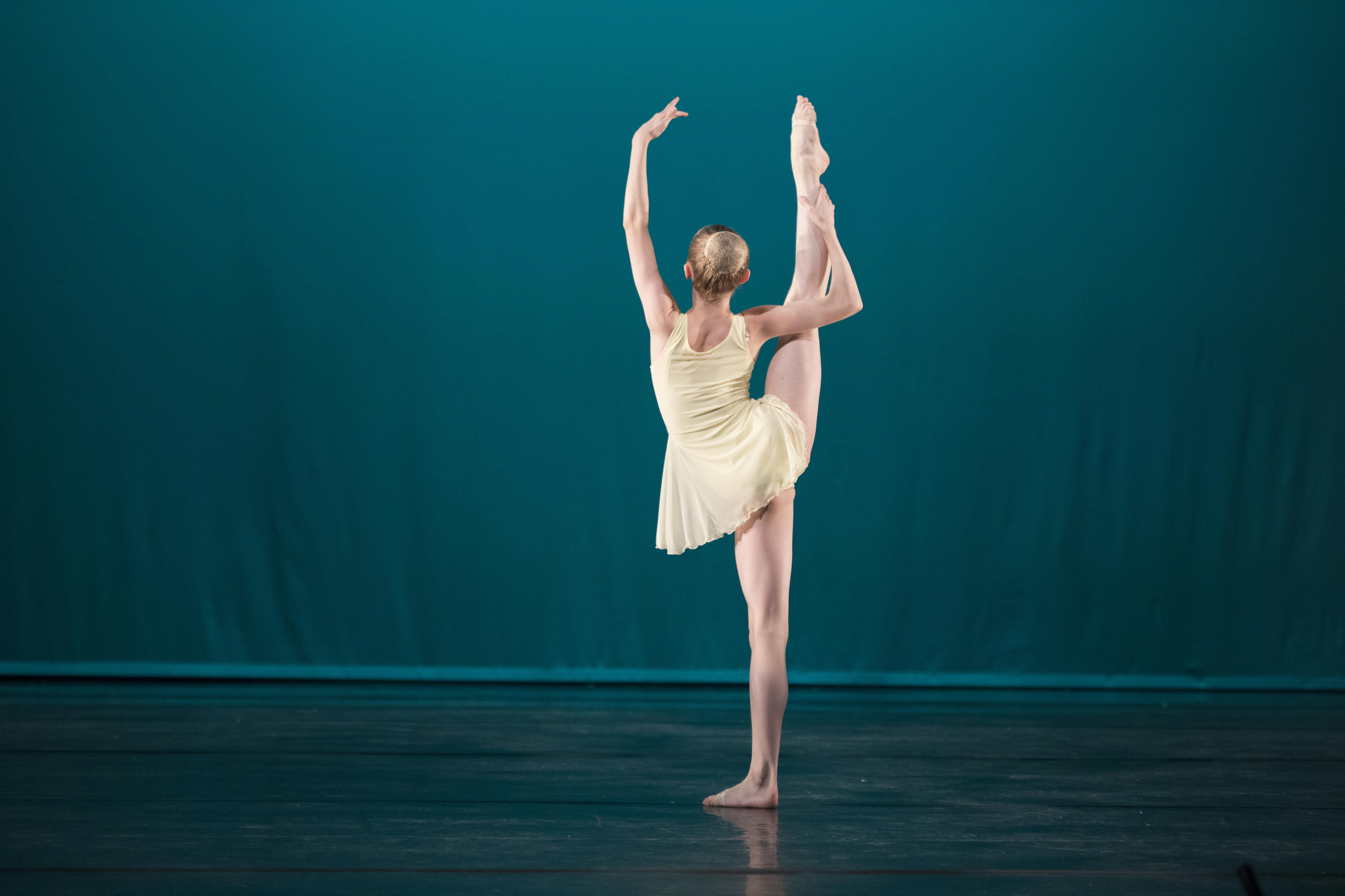 Girl Holding Leg